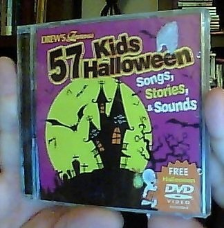 Drew's Famous 57 Kids Halloween Songs, Stories & Sounds by The Hit Crew (0100-01-01)]()