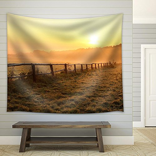 Sunrise over Misty Grassland with Wooden Fence in the Foreground Fabric Wall Tapestry