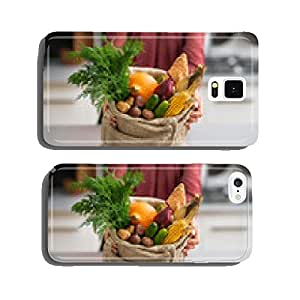 Closeup on housewife showing fresh vegetables in shopping bag cell phone cover case Samsung S5