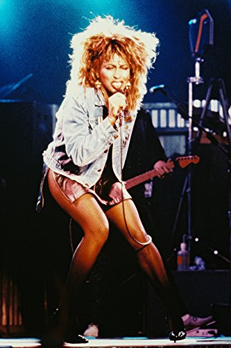 Tina Turner iconic denim jacket and short skirt in concert 18x24 Poster ()
