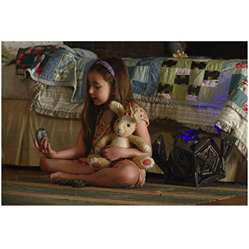 The Survive Mimzy Rhiannon Leigh Wryn as Emma Sitting on Floor with Stuffed Bunny 8 x 10 inch photo