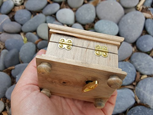 Christmas engraved music box with a Nativity scene on top, playing Adeste Fideles (O Come, All Ye Faithful)