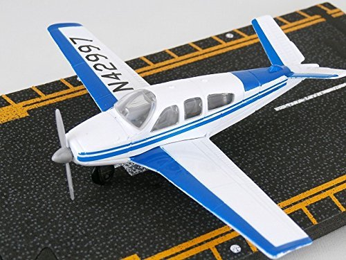 Daron Beechcraft Bonanza (Blue / White) airplane die-cast with runway (Hot Wings) ()