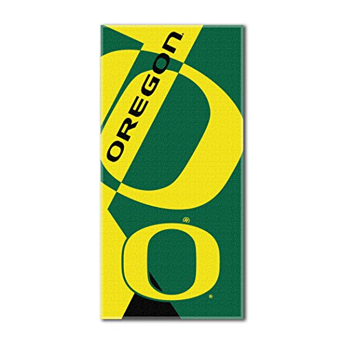 - The Northwest Company Officially Licensed NCAA Oregon Ducks Puzzle Beach Towel, 34