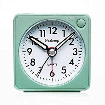 "Peakeep Ultra Small, Battery Travel Alarm Clock with Snooze and Light, Silent with No Ticking Analog Quartz (A - Ultra Small (2 ¼"" x 2 ¼"" x 1 ¼""), light weight (2 oz), square features make this travel alarm clock stands out in a crowd. It fits easily into a suitcase even your pocket during your journey. A large convenient alarm on/off switch is located on top where it is easy to reach. Easy access snooze and light bar is on right hand side of the front, away from the backside time and alarm setting wheel. Manual-backlit illuminated dial glows evenly across the entire dial for night time viewing. Luminous hands will glow for a few minutes after the lights have been turned off. - clocks, bedroom-decor, bedroom - 51pkCwssNjL. SS400  -"