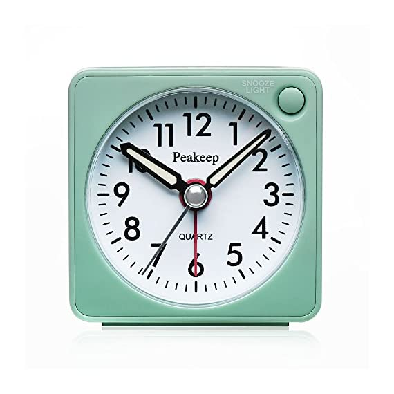 """Peakeep Ultra Small, Battery Travel Alarm Clock with Snooze and Light, Silent with No Ticking Analog Quartz (Aquamarine) - Ultra Small (2 ¼"""" x 2 ¼"""" x 1 ¼""""), light weight (2 oz), square features make this travel alarm clock stands out in a crowd. It fits easily into a suitcase even your pocket during your journey. A large convenient alarm on/off switch is located on top where it is easy to reach. Easy access snooze and light bar is on right hand side of the front, away from the backside time and alarm setting wheel. Manual-backlit illuminated dial glows evenly across the entire dial for night time viewing. Luminous hands will glow for a few minutes after the lights have been turned off. - clocks, bedroom-decor, bedroom - 51pkCwssNjL. SS570  -"""