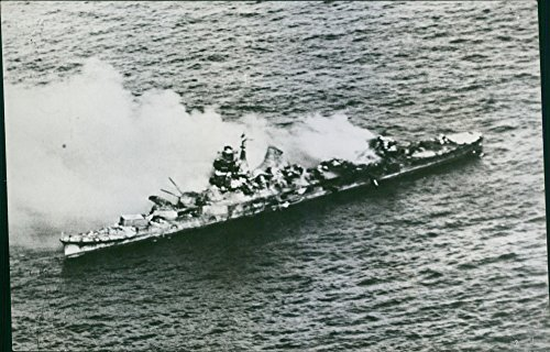 Vintage photo of Japanese cruiser torn apart by bombs and torpedos of the U.S. aviators. ()