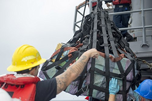 Home Comforts Sailors load part of an intercepted drug shipm