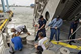 Home Comforts U.S. Sailors and civil service mariners heave mooring lines aboard the joint high speed vessel USNS