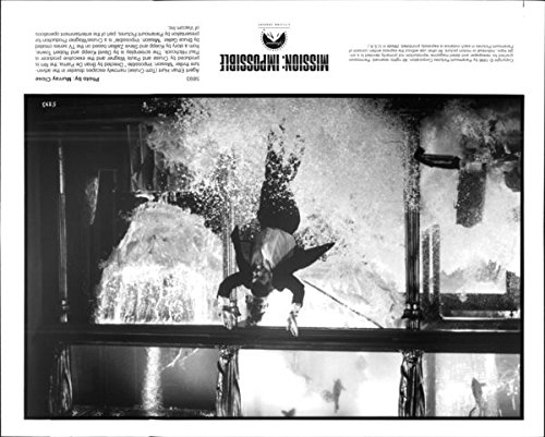 vintage-photo-of-tom-cruise-jumping-in-water-in-mission-impossible-movie