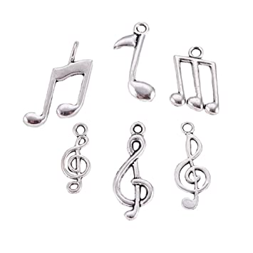 A TIBETAN SILVER MUSICAL NOTE NECKLACE /&  EARRING SET NEW.