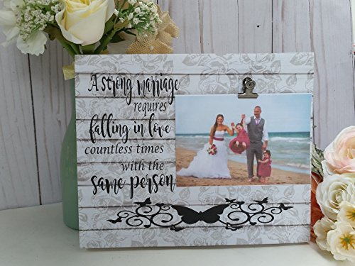 Wooden picture frame, A strong marriage requires falling in love countless times with the same person. Your choice of colors, measures 8x10in