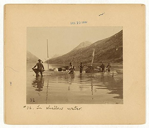 Photo: In shallow water,men in boats,river,Yukon Territory,December c1897,Gold Miners