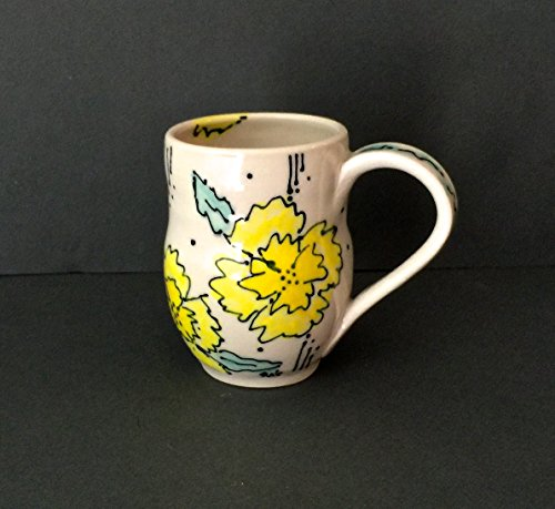 (Hand thrown yellow and white stoneware mug decorated in a contemporary Majolica style )