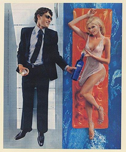 2006-skyy-vodka-19-the-palms-guy-girl-in-pool-print-ad-65114