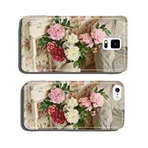 Artificial flowers in a decorative vase standing on the floor in cell phone cover case iPhone5