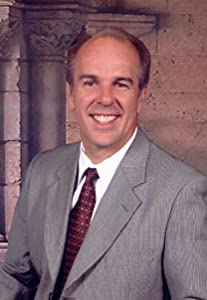 Dr.  Johnny Mark Teague