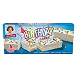 Festive vanilla flavored cakes, baked with candy confetti, coated with white icing and topped with colorful sprinkles.