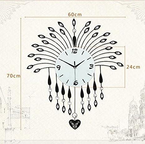 Amazon.com: Jedfild Rocking Wall Clock Drawing continental creative Iron Art Clocks ultra-quiet bedroom clock: Home & Kitchen