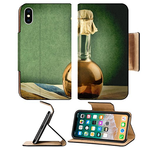 MSD Premium Apple iPhone X Flip Pu Leather Wallet Case Old bottle with vegetable oil on a wooden table IMAGE ()