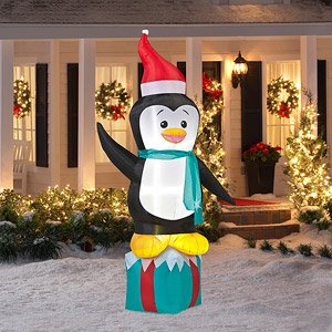 8 39 tall penguin on present christmas airblown for Airblown nutcracker holiday lawn decoration