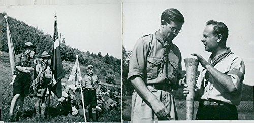 Vintage photo of T.H. Staff manager Gustav Kolthoff shows a nail stud for D. Sporrong. TV. Danish scouts are breathing after the march to the camp
