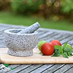 ChefSofi Mortar and Pestle Set - 6 Inch - 2 Cup Capacity - Unpolished Heavy Granite for Enhanced Performance and Organic Appearance - INCLUDED: Anti-Scratch Protector + Italian Recipes EBook 18 A kitchen must-have: Mortar and pestle set (mortero de cocina - morter and pessel - molcajete or guacamole bowl and pestel) has been used for THOUSANDS of years as THE way to crush, grind and powder herbs and dry spices. Contrary to an electric grinder or crusher, the age-old, durable, traditional manual grinding method ensures that all cooking ingredients bring out their full flavor and aroma profiles, allowing you to further control their texture and make delicious, chunk-free dishes. Versatile tool: Take advantage of your brand new stone motar and pedestal set's various applications in the kitchen and simplify your everyday life! Use your mortor to pulverize nuts, seeds, ginger root and garlic and make homemade salad dressing, sauces and condiments, such as fresh mustard, quacamole, pesto, salsa, chutneys and more. Widely used in pharmacies and apothecaries, your molcajete set will help you powder pills, for optimal ingestion, or hide them in your stubborn pet's kibble! Effortless use: This ChefSofi stone mocajetes motor & pedestal set was designed with your convenience in mind. Made from unpolished granite, you will waste no time fumbling or stabilizing your pestal masher, as our motar's cup interior provides the best, metate-like natural friction for swift ingredient crushing, grinding or powdering. With a 500 ml (approx. 2 Cup) capacity, this stone mortor also reduces the need for ingredient refills, affording quick food prep, in one go!