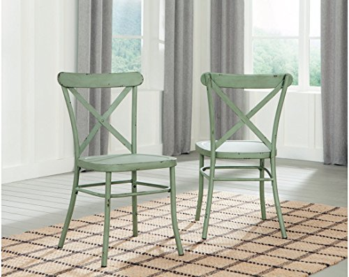 Ashley Furniture Signature Design - Minnona Dining Side Chair - Set of 2 - Cross Back - Vintage Casual Style - Antique Light Green Finished Metal - CRAFTED WITH PRIDE: Inspired by Parisian café style. The Minoan dining room chair is a striking infusion of industrial and vintage. Supportive frame is built with a slightly curved back and concave seat to provide a comfortable sitting experience. Rub through effect on the edges of the metal frame establishes attractive timeworn appeal. Streamlined design appearance with X-back stays in fashion for years to come. DIRECT FROM THE MANUFACTURER: Ashley Furniture goes the extra mile to package, protect and deliver your purchase in a timely manner BUY WITH CONFIDENCE: Designed and manufactured by Ashley Furniture Industries. The trusted source for stylish furniture, lighting, rugs, accessories and mattresses. For every taste and budget - kitchen-dining-room-furniture, kitchen-dining-room, kitchen-dining-room-chairs - 51qGIBlMaCL -