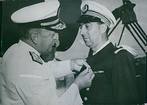 (Vintage photo of Vice - Admiral H.K. Hewitt, commander of U.S. naval forces in the Mediterranean, pins the American Legion of Merit medal on the French commander of the destroyer escort Senegalais, which sank a German submarine in the Mediterranean. 1944.)