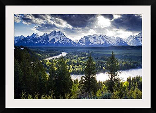 GreatBIGCanvas Beams of light penetrate the clouds at the classic Snake River, Wyoming Photographic