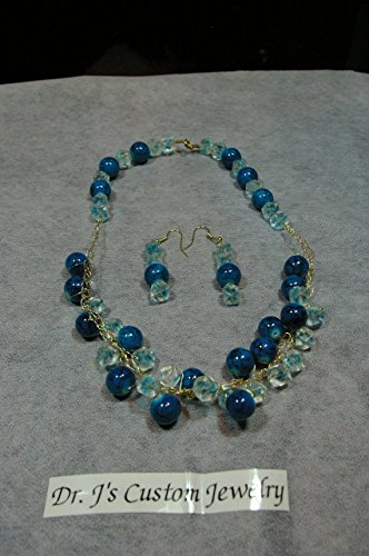 Gold Colored Crocheted Wire with Blue and BlackRondelle Round Beads and clear with blue beads and twist button closure. Necklace Set with Matching Earrings.