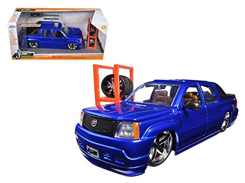 2002-124-scale-cadillac-escalade-ext-just-trucks-serial-with-extra-wheels-and-rack-blue