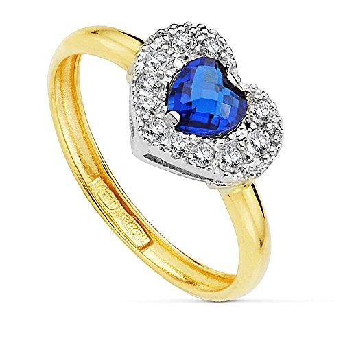 Bague 18k bicolor coeur or pierre bleue centre de 5 mm. [AB2424]
