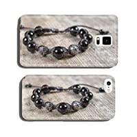 Popular Buddhist bracelet shamballa on a wooden background cell phone cover case iPhone5