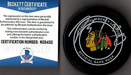 Signed Patrick Sharp Puck - Beckett bas Real 92 - Beckett Authentication - Autographed NHL Pucks (Patrick Sharp Puck)