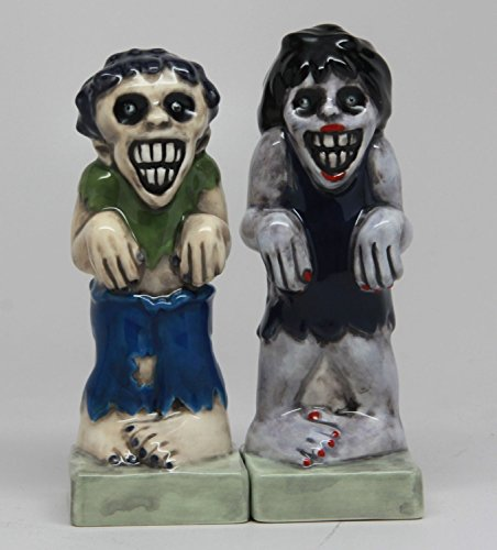 Zombies Magnetic Ceramic Halloween Salt and Pepper Shakers]()