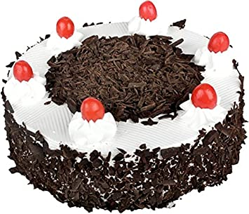 Sattva Flower Boutique Contains A Black Forest Cake Weighs 1 2 Kg Cakes And Fresh Flowers
