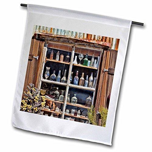 Danita Delimont - Jaynes Gallery - Shops - USA, California, Randsburg. Bottles in window of abandoned store. - 18 x 27 inch Garden Flag - In Stores Gallery The