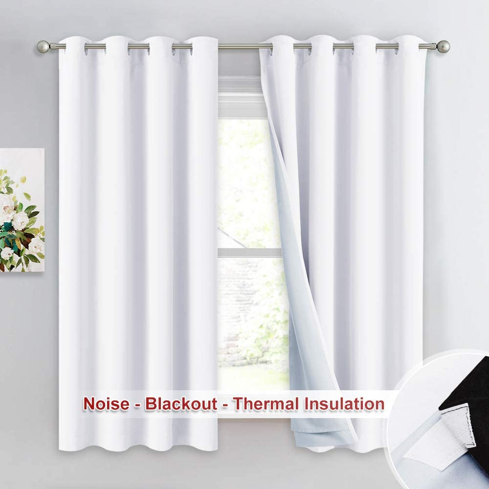 NICETOWN White 100% Blackout Lined Curtains, 3 Thick Layers Completely Blackout Noise Reducing Window Treatment Insulated Drapes for Bedroom (1 Pair, 52 inches Width x 63 inches Length Each Panel)
