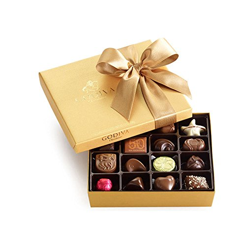 Our 19 piece Gold Ballotin features a signature assortment of classic Godiva Belgian chocolates. In each piece you will discover exquisitely rich, velvety chocolate, with fascinating flavors and intriguing textures. Finished with classic, two...