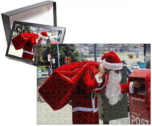 Media Storehouse 252 Piece Puzzle of Man Dressed as Santa Claus Putting Letter in Mail Box, Side View (10387554)