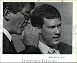 This is an original press photo. Attorney Pat Stiley talks with jail officer Matt W Davis. Jails- Spokane County- City- Personnel Photo measures 10 x 8.25inches. Photo is dated 10-17-1988.