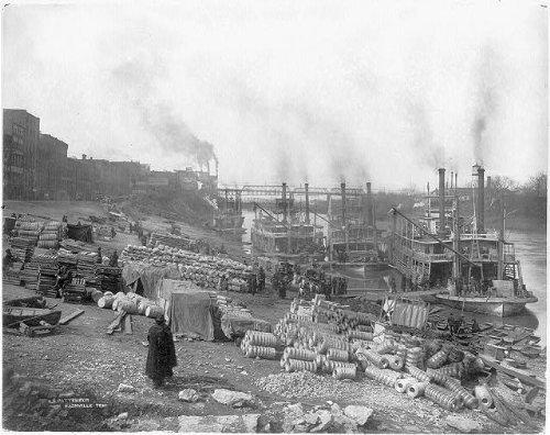 Photo: Riverboats,sternwheelers,tied up at riverbank barrels,sack,palettes,Nashville,TN