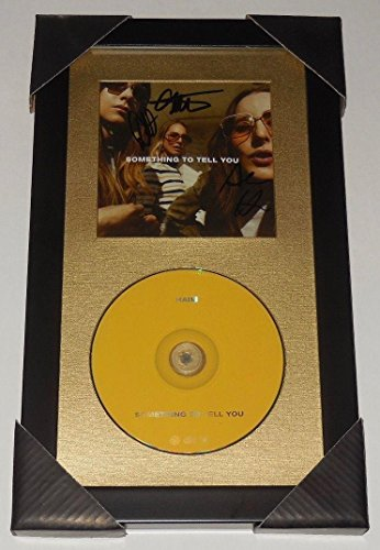 HAIM AUTOGRAPHED SOMETHING TO TELL YOU CD (FRAMED & MATTED) - Este, -