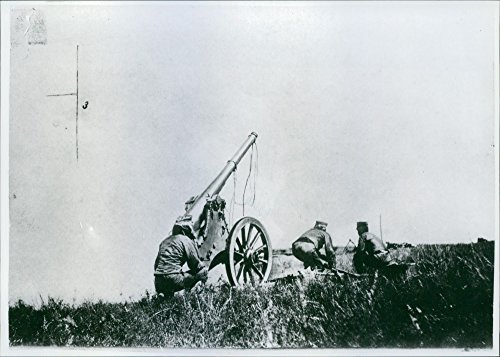 Vintage photo of Soldiers hidden while firing using by cannon during German (German Cannon)