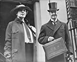 Vintage photo of Arthur Neville Chamberlain standing with his wife, Anne Chamberlain carrying briefcase, London, 1936.