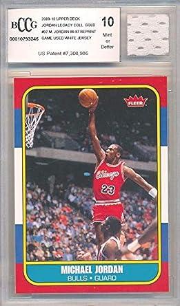 433915f323b 1986 Fleer Michael Jordan Rookie Replica with Piece of Authentic Michael Jordan  Chicago Bulls GAME USED