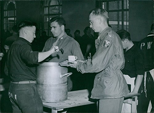 (Vintage photo of The kitchen staff at the university are all German prisoners of war working under American supervision. Here getting service is 1st Lt. William L. Bridges of Kansas)