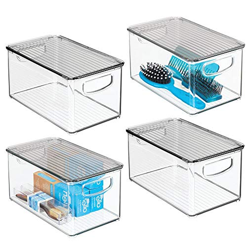 """mDesign Plastic Bathroom Storage Bin with Handles, Lid - Holds Soap, Body Wash, Shampoo, Lotion, Conditioner, Hand Towels, Hair Accessories, Body Spray, Mouthwash - 10"""" Long, 4 Pack - Clear/Smoke Gray"""