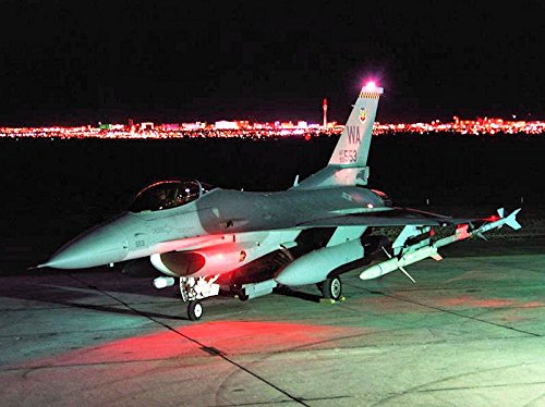 Bob Marley Fighter (USAF F-16C block 52 #93-0553 from the USAF Fighter Weapons School sits on the ramp at Nellis AFB at)